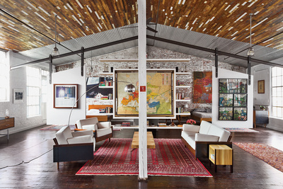 Renovated factory building interior living room with brick wall and wood floors and wooden joist
