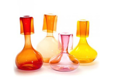 a bulb-like set of glass pitchers and cups for the kitchen
