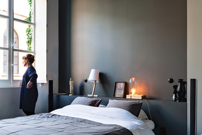 a dark gray bedroom