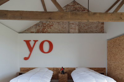 ochre barn pitched roof guest room beds