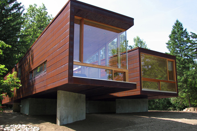 the steel and glass exterior of a modular prefab home in Michigan