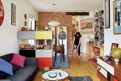 Bright living area with Eames storage unit and graphic prints