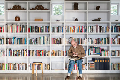 Orcas Island library with shelves of books and Artek stool
