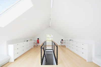 Attic remodel features bamboo flooring and built-in cabinets.