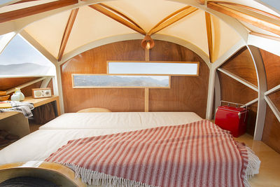 Hutte Hut prefab trailer interior with bed