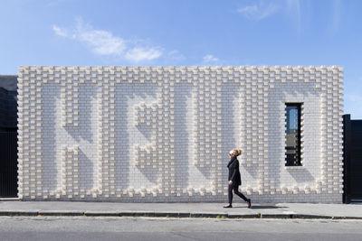 hello house white brick exterior  0