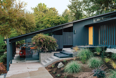 midcentury renewal black exterior car port