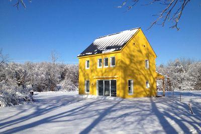 yellow maine passive house