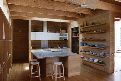 Australian tallowwood kitchen with Artek stools and Muuto lighting
