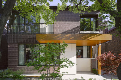 modern toronto house clad in brick and wood