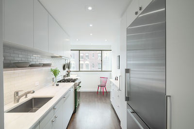 sweeten upper east side kitchen white stainless steel appliances
