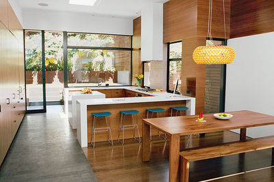 object lesson san francisco renovation kitchen walnut veneers caesarstone countertops pendant table bench