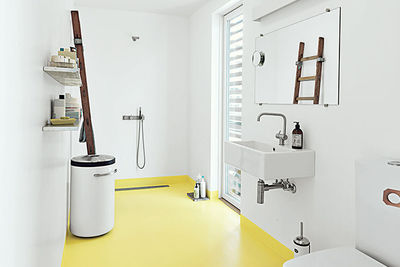 come home to high water copehagen floating home epoxy floor bathroom glassia sink tub vola faucets vipp laundry bin rec