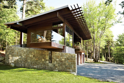 arts and crafted cabin stone foundation copper roof