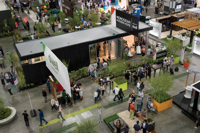 Prefab homes and greenery at 2015 Dwell on Design LA's Outdoor area.
