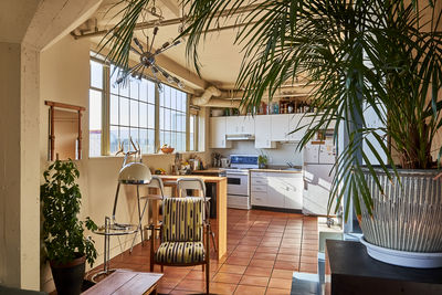 Eclectic kitchen in home of two artists, located in a Vancouver warehouse.