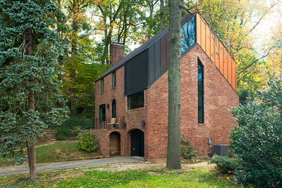 A renovated brick house with metal standing-seam roof in Arlington, Virginia