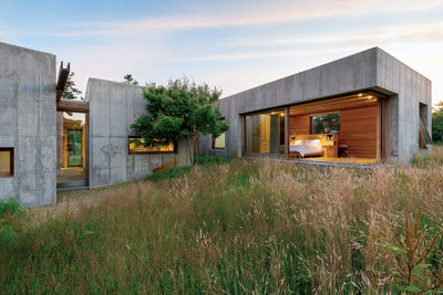 a movable feat marthas vineyard prefab modular concrete boxes facade wood paneling