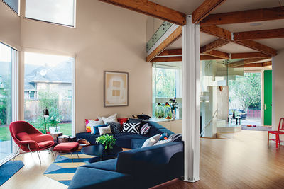 Modern prefab modular and triangular home by HOMB in Portland living room with custom sofa