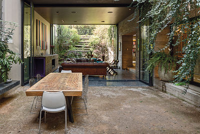 alazraki residence mexico city outdoor dining room harry bertoia chairs mango wood table diego madrazo
