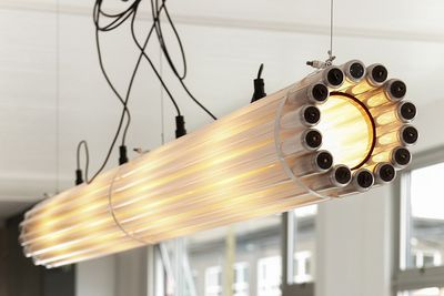 Substantial pendant light made with recycled lighting