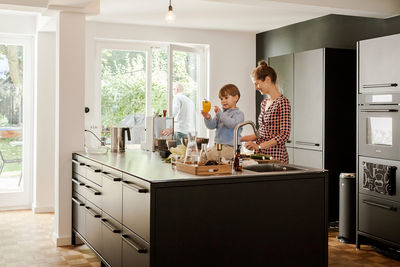 dinner is served germany family home kitchen island windows oak parquet flooring