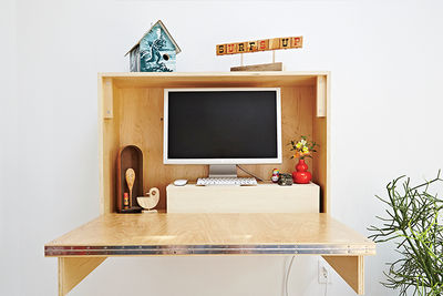 Built-in folding desk in a backyard addition at a Massachusetts home
