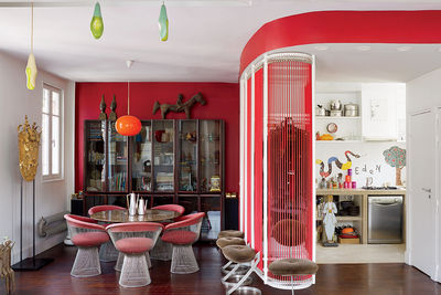 french fix paris apartment nicolas roche bobois dining room luxus lamp warren platner table chairs rosewood glass cabinet soriano luceplan pendants