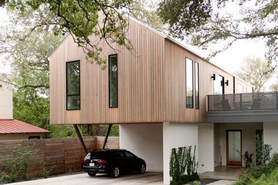 gable game austin texas cantilevered home facade windows upper level car port