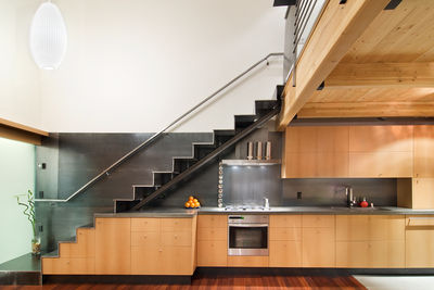 A staircase hovers above architect Jack Hawkins' kitchen