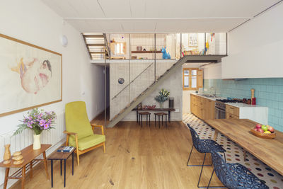 A renovated row house combines the living room and kitchen with colorful details.