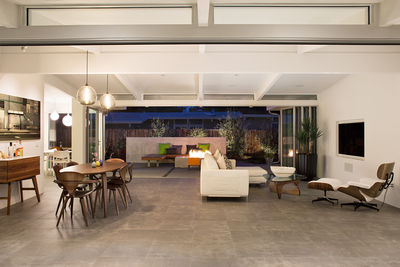 Palo Alto Eichler Renovation Open Living and Dining Areas with glass wall