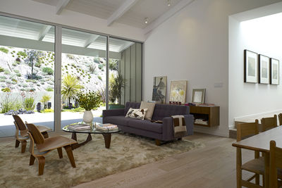 Noguchi glass coffee table and Eames molded plywood chairs in Los Angeles renovation by Montalba Architects.