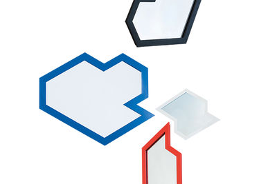 Geometric, powder-coated steel mirrors by Jonathan Nesci