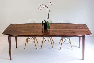 Elegant dining table in rich walnut wood