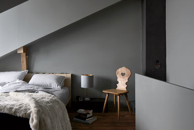 Bedroom of Swiss renovation by Jonathan Tuckney.