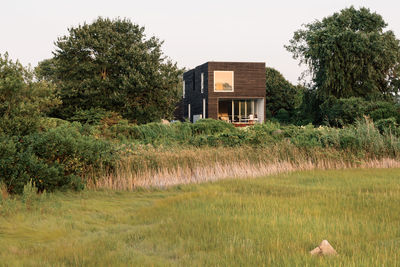 Charred, brushed, and oiled cypress facade of Rhode Island family vacation home by Bernheimer Architecture.