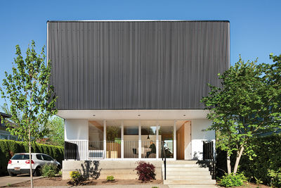 Affordable Portland home upper floor wrapped in black corrugated steel
