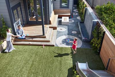 ripple effect san fancisco small space yard outdoor monica viarengo pebble mosiac artificial turf slide