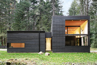 Black stained cedar siding on Washington state home.