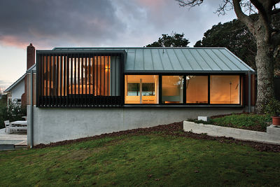 New Zealand home with anodized aluminum louvers by the master bedroom