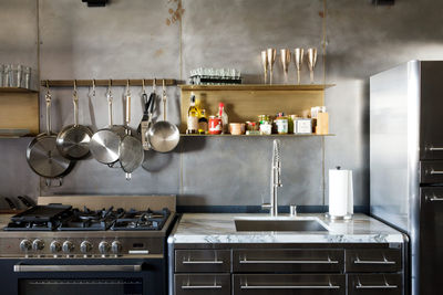 toy story industrial kitchen los angeles renovation toy lofts brass shelves steel wall hayneedle pot rack verona range