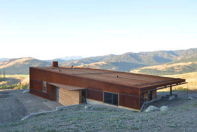 Weathering steel, glass, cedar facade of cabin by Johnston Architects in Washington State.