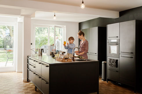 Renovation of 1967 Hamburg apartment with Vipp kitchen.