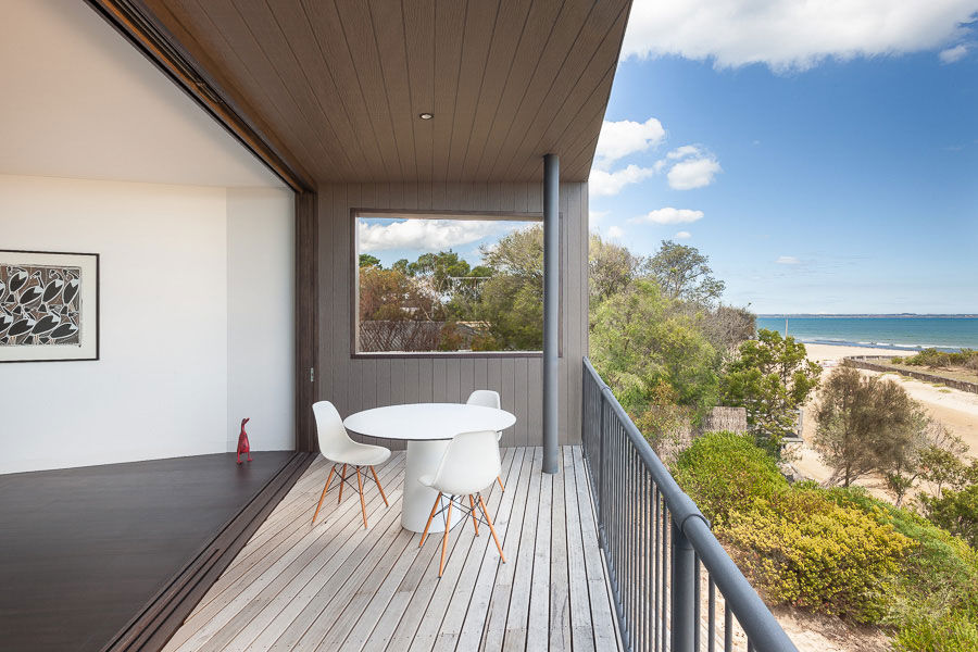 A deck looks out onto the beach in Australia
