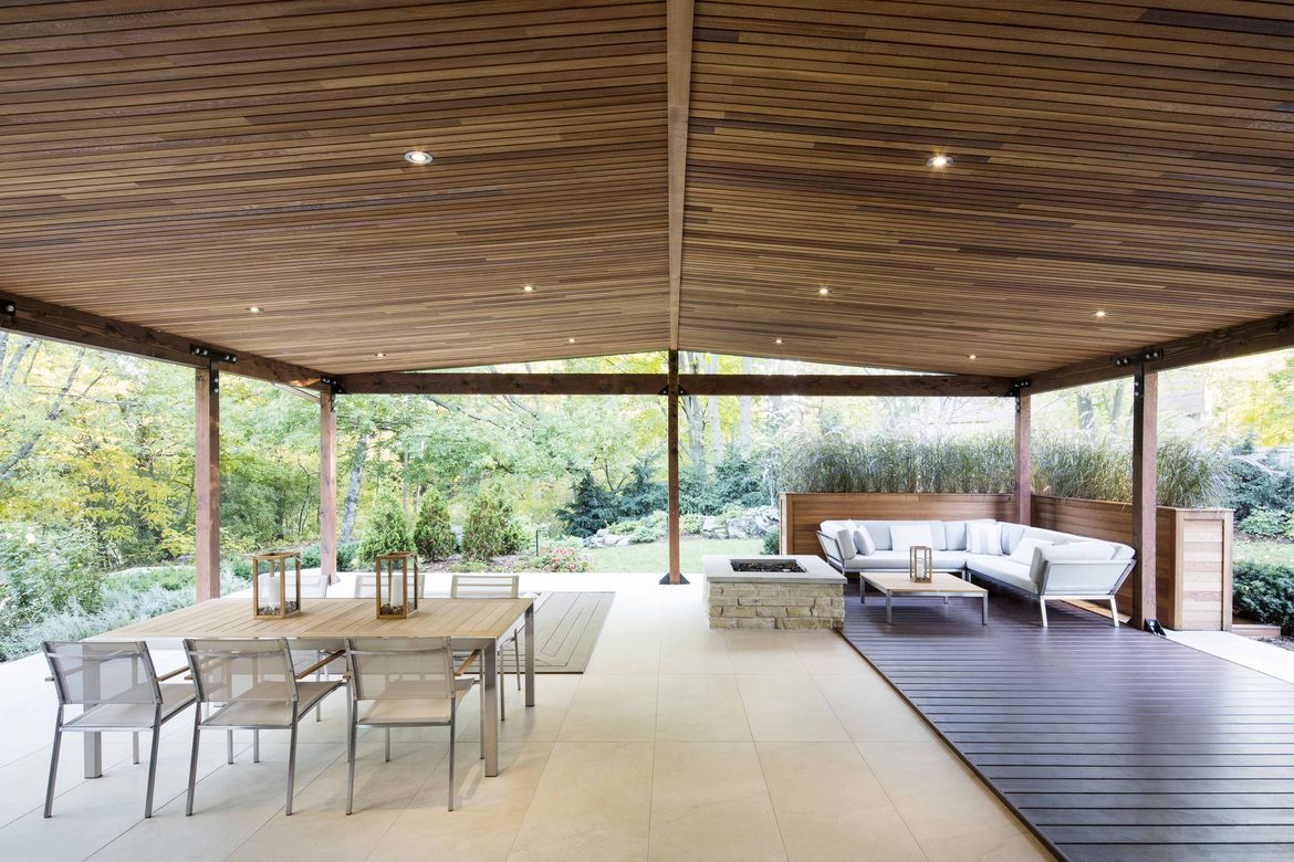 Deck overlooking a river at a midcentury renovation