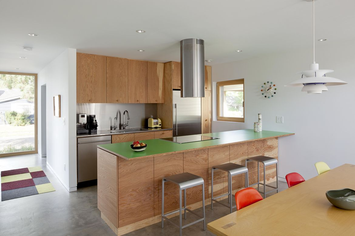 Skidmore Passivhaus kitchen with green laminate countertop
