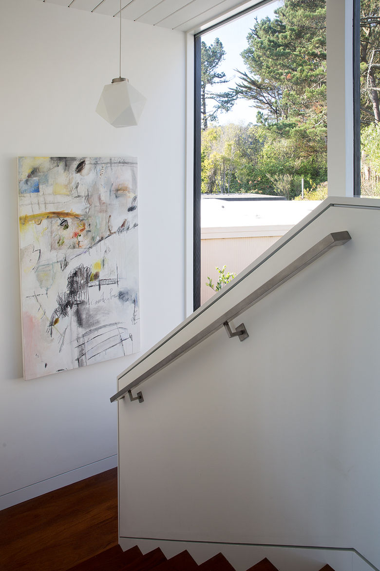 Staircase with double-height glass windows in San Francisco