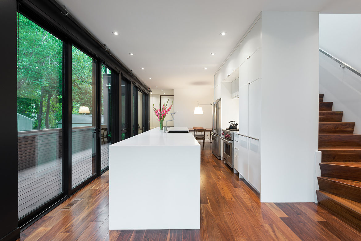White lacquered kitchen with walnut flooring in Toronto
