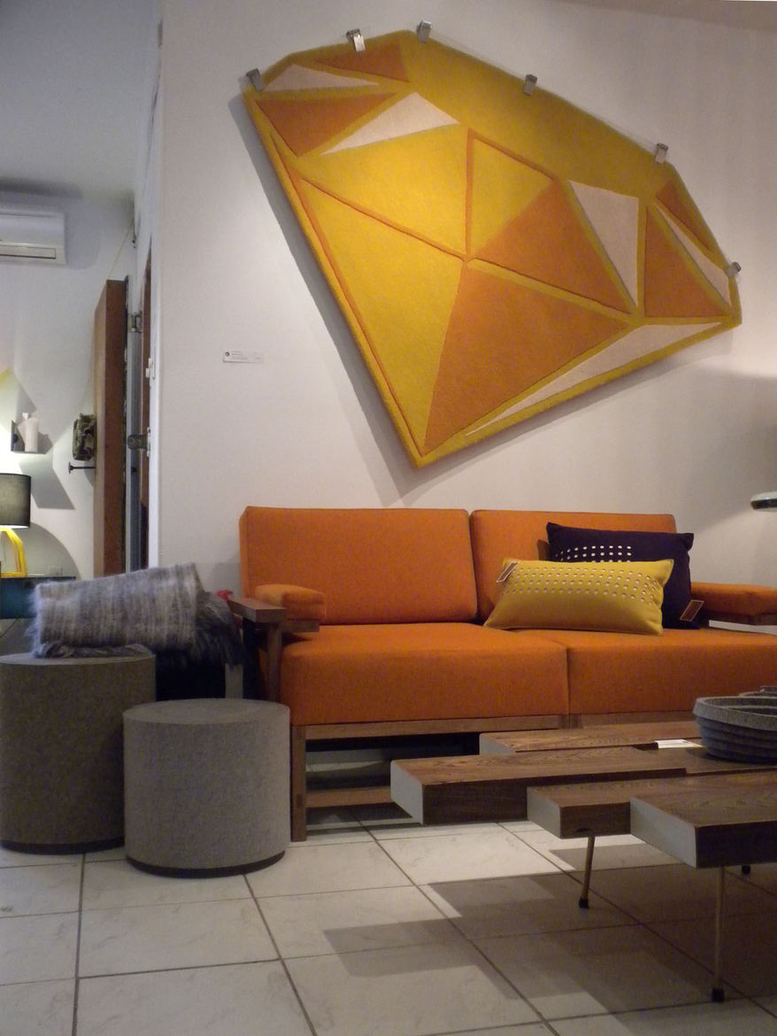"""The shop functions as store and gallery. This vignette features a Terrace coffee table by Toronto designer <a href=""""http://www.lubodesign.com"""">Lubo Brezina</a> as well as a Gem Collection rug by <a href=""""http://www.bevhisey.com"""">Bev Hisey</a>, another loc"""